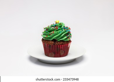 Cupcake. The concept of Christmas baking. Confection on a light background
