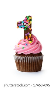Cupcake decorated with a chocolate number one