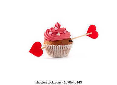 Cupcake decorated with sugar hearts and a cupid arrow for Valentine's Day isolated on white background