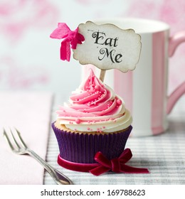 "Cupcake with ""Eat Me"" pick"