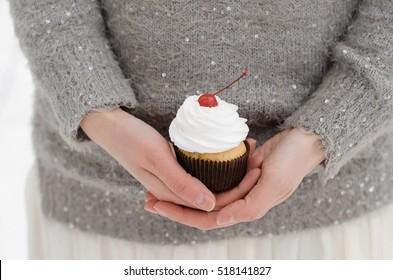 Cupcake in girl's hands