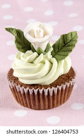 cupcake with mint butter cream and white rose