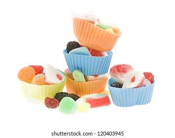 cupcake molds with candy isolated on a white background