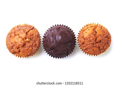 Cupcake, muffin with raisins and chocolate isolated on white background. Delicious homemade Muffins. Top view.