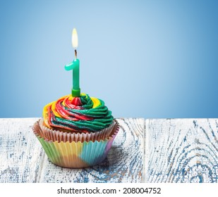 Cupcake with number one on a blue background. birthday greetings