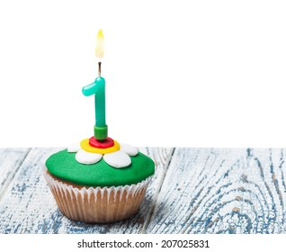 Cupcake with number one on white background isolated