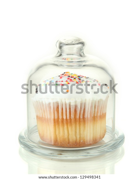Cupcake on glass saucer, isolated on white