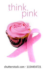 A cupcake with pink icing and a pink felt awareness ribbon on white background for Breast Cancer Awareness month in October. Vertical image with think pink message