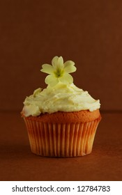 Cupcake with primrose flower on top