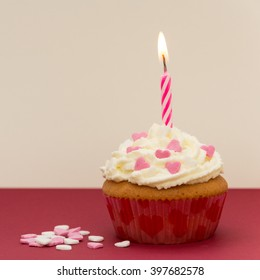 cupcake with red candle and heart decoration