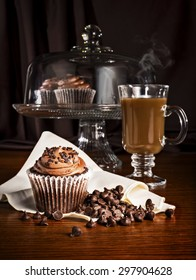 Cupcake and steaming coffee