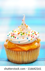 Cupcake with whipped cream and icing