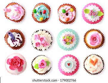 cupcakes with beautiful decoration isolated over white background. shoot from top