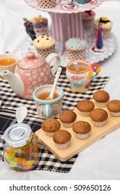 cupcakes, berries, candies, chocolate, nuts and tea set