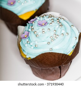 cupcakes with blue frosting and sprinkles