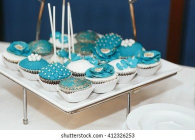 Cupcakes with blue pearl and flowers decorations