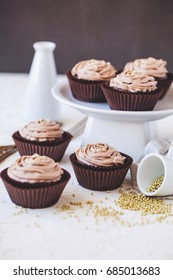 Cupcakes with chocolate cream over white background
