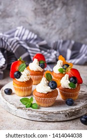 Cupcakes with cream and berries. Sweets for summer party