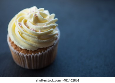 Cupcakes desert cream with space for text on a stone background