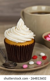 Cupcakes with frosting and hearts. Selective soft focus.