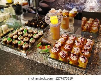 Cupcakes Kadaif ith whipped cream and berries. Chocolate cupcakes with oreo buttercream. Festive gourmet Dessert