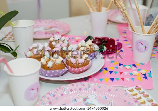 Cupcakes Marshmallows On Table Pink Napkins Stock Photo