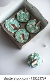 cupcakes with mascarpone cheese cream in a gift box. Decorated with marshmalow
