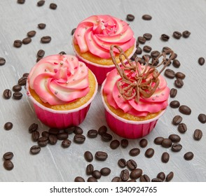 Cupcakes on gray wooden background