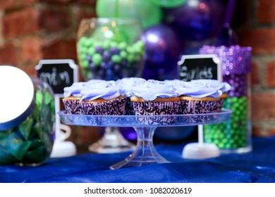 cupcakes on tray on table with decorations