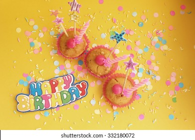 Cupcakes on yellow confetti background - happy birthday card