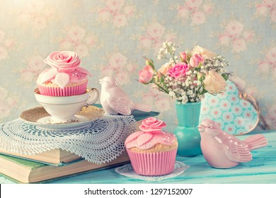 Cupcakes with pink flowers. Retro vintage still life.