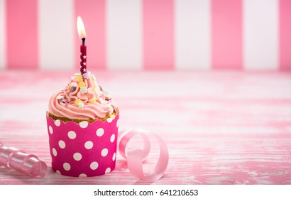 Cupcakes with pink and white  icing