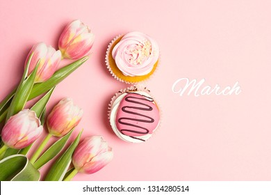 Cupcakes in shape of number 8 with tulip flowers on pink pastel background. International Women's Day concept, March 8.