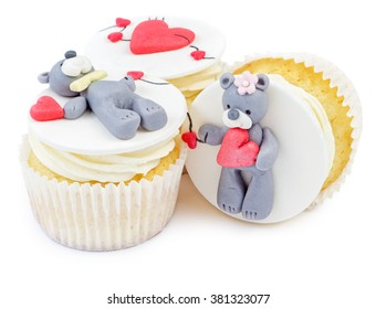 Cupcakes with teddy bear and hearts isolated on white background. Valentine's Day cupcake.