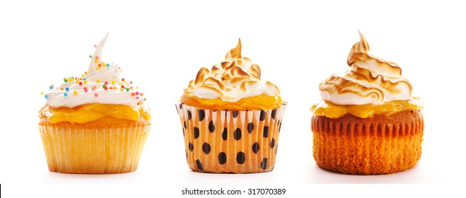 Cupcakes with whipped cream set isolated on white