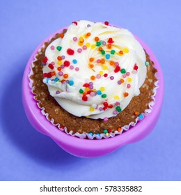 the Cupcakes with white cream on the blue background, arranged for a party or a wedding reception