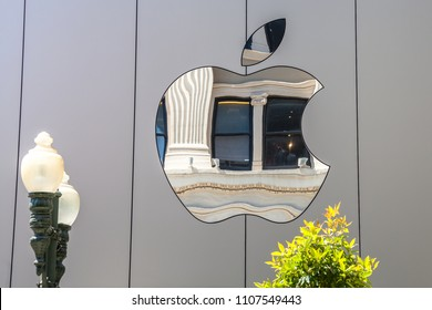 Cupertino, CA, United States - August 15, 2016: Apple sign on the Apple world headquarters at One Infinite Loop, Cupertino in Silicon Valley. Apple Inc. is an American multinational technology company