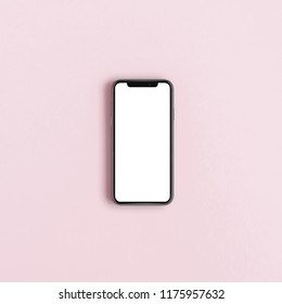CUPERTINO, CALIFORNIA / USA - 12 SEPTEMBER, 2018: New smart phone iPhone XS by Apple with blank screen space isolated on pink background. Flat lay, top view.