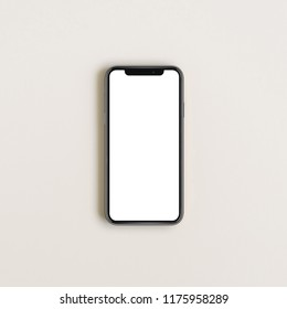 CUPERTINO, CALIFORNIA / USA - 12 SEPTEMBER, 2018: New model of cell phone iPhone XS Max by Apple with blank screen isolated on background. Flat lay, top view.