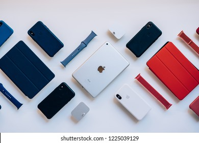 Cupertino, California / USA - November,8, 2018 Apple Store Products. Ipad tablet, touch pad case, Iphone X, protection case, charge station, watchband. Modern electronics with logo and accessories