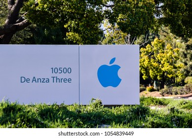 Cupertino, CA/USA - Mar. 25, 2018: Apple Company logo marks entrance to company's campus on De Anza Boulevard in Cupertino, CA