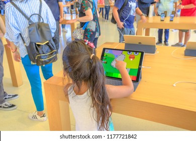 Cupertino,CA,United States - August 12, 2018: Child playing a kids app on Ipad in the new Apple store and Headquarters of Apple Park Visitor Center, Tantau Avenue, Cupertino, Silicon Valley,California