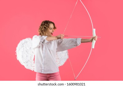 Cupid shoot love arrow with bow for valentine day. Female angel with bow and arrow. Valentines day cupid. Cupid angel with bow and arrow. Valentines Day concept. Arrow of love. Cupid in valentine day.