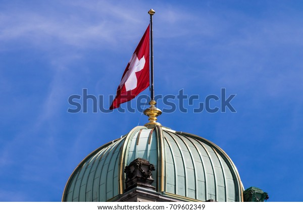 Cupola with Swiss flag on Swiss Federal Palace Bundeshaus in Bern