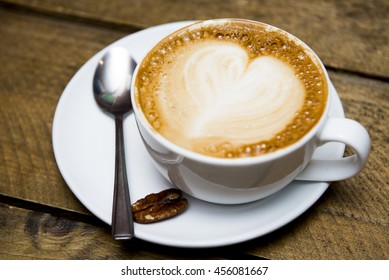Cuppuccino cup with heart shape