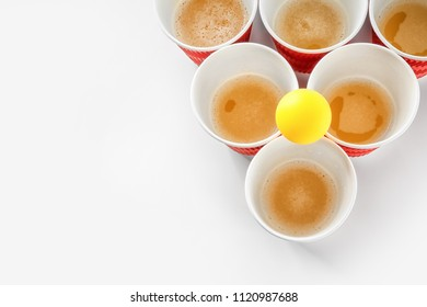 Cups and ball for beer pong on white background