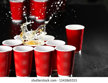 Cups for beer pong game on table