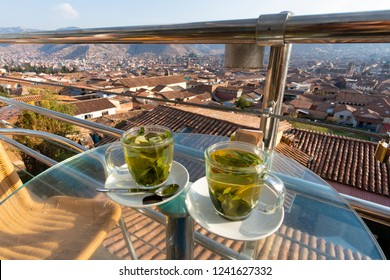 Cups of coca tea with view of Cusco city in Peru. It is a traditional tea for fighting altitude sickness