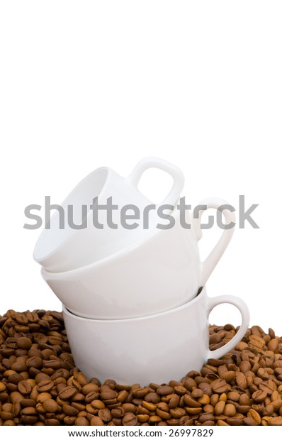 Cups and coffee beans isolated on the white