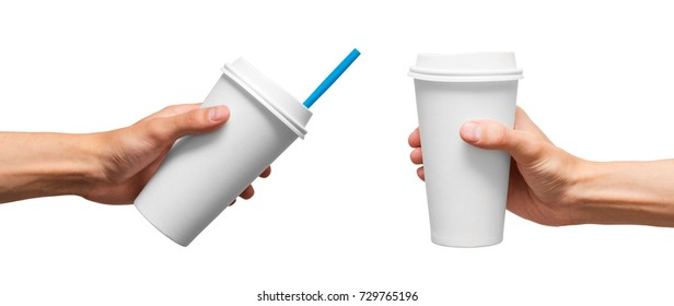 Cups of coffee in hand. White cup in hand.